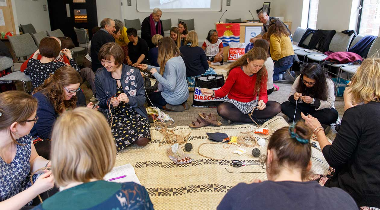 Photograph of participants in a weaving workshop