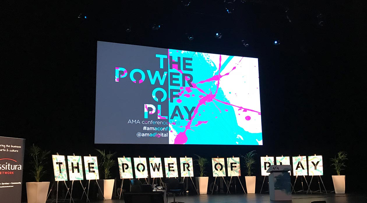 The stage at conference withPower of Play written on the screen