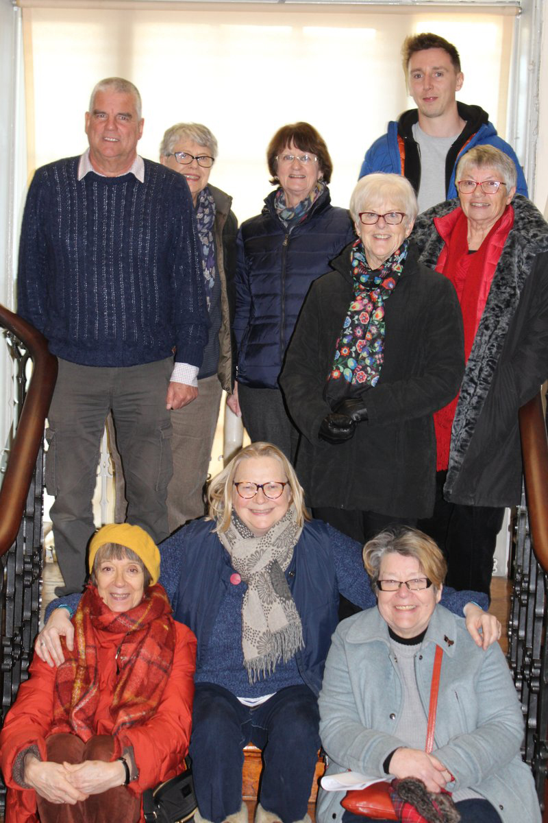 A happy group of staff and volunteers pose for a group photo