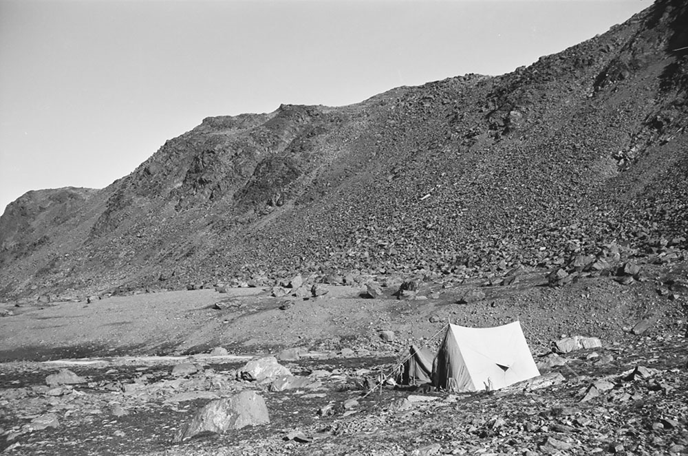 A tent in a rocky landscape