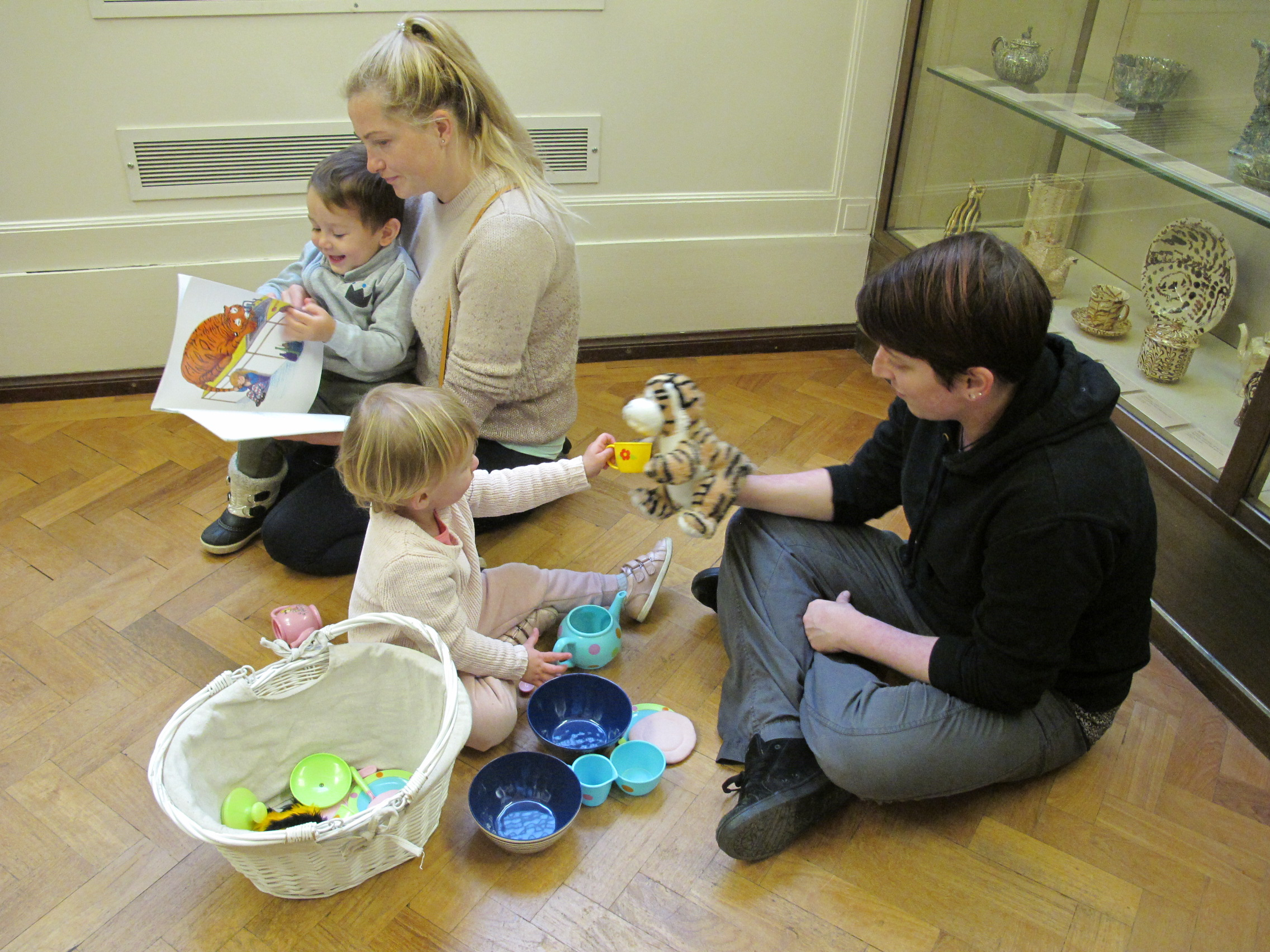Parents and children taking part in activities in the Fitzwilliam Museum galleries