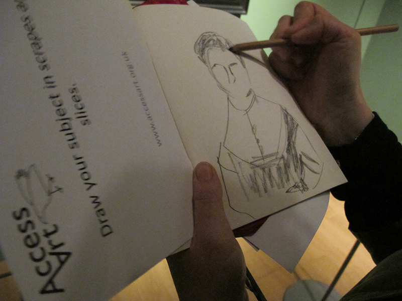 Close up on a paper workbook, where a participant is sketching