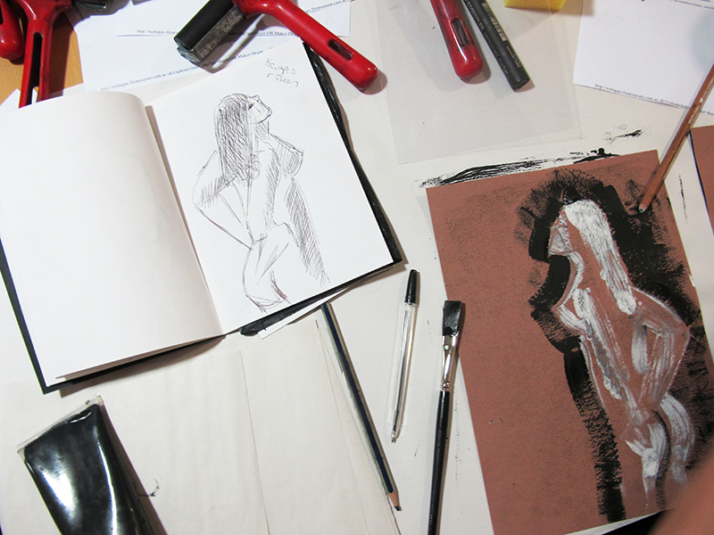 A print and sketch side by side. The print is of a female figure.