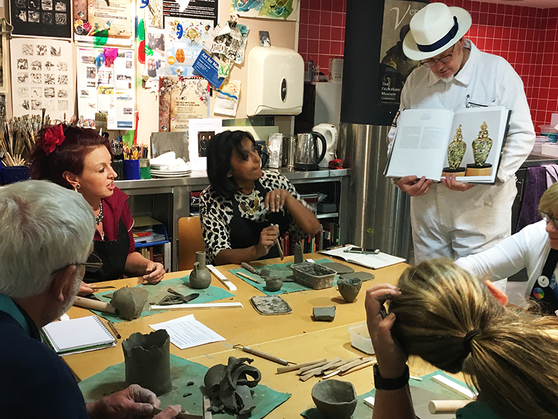Participants working with clay in the studio