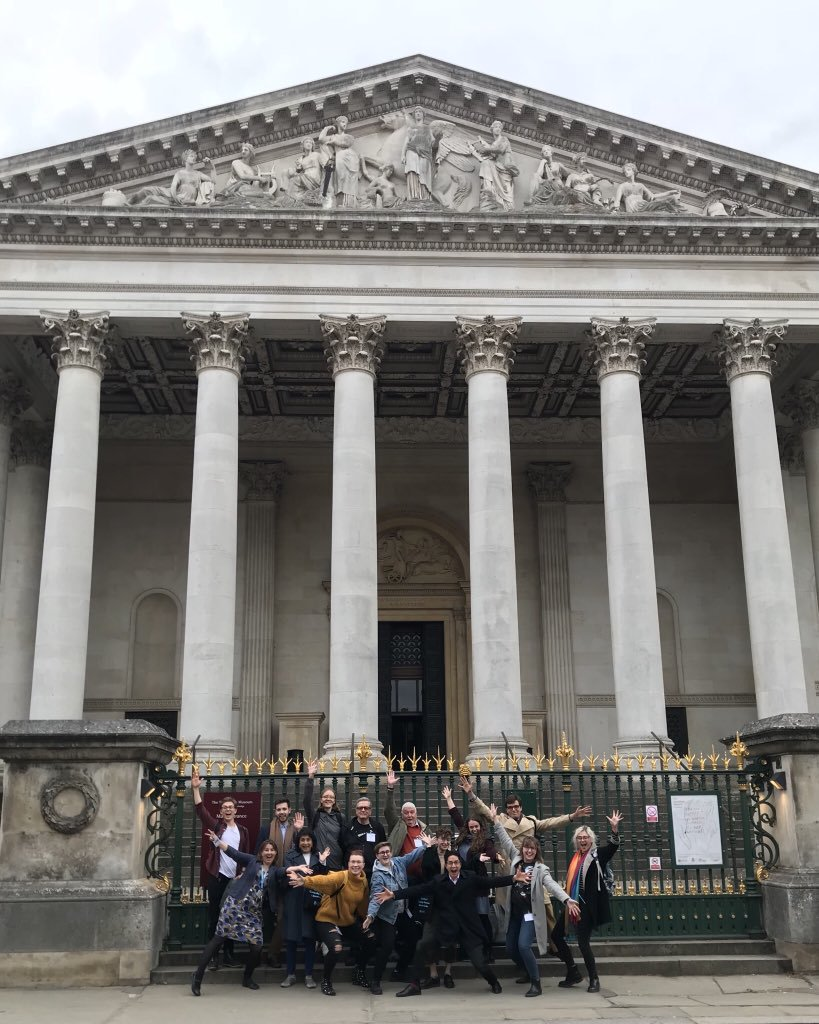 The volunteer team celebrate their training outside the Fitzwilliam Museum.