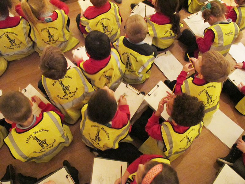 Class of children with clipboards