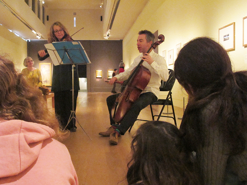 musicians perform in the exhibitions gallery