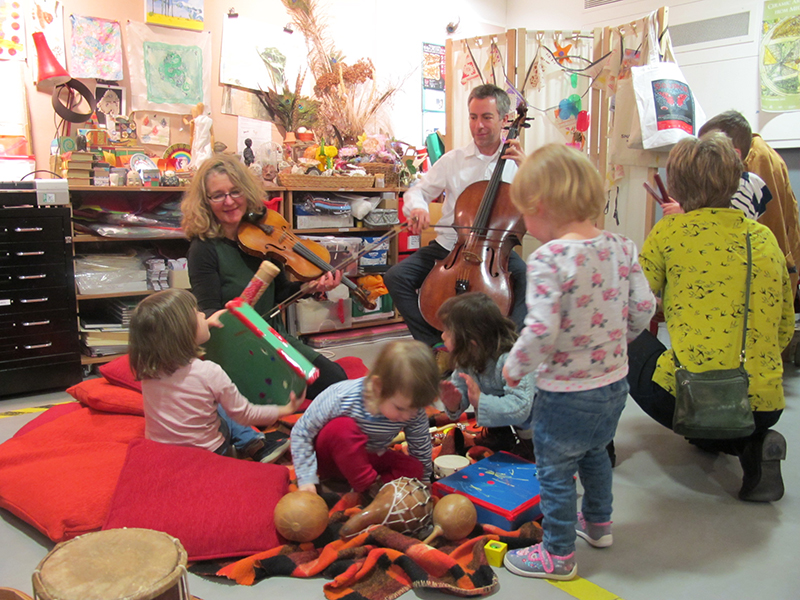playing music with children in the studio