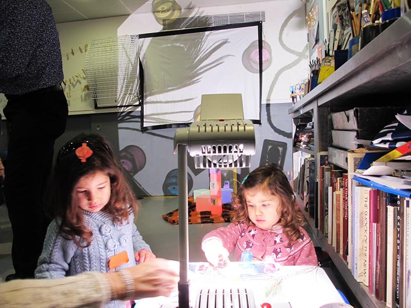 two little girls make shadow art
