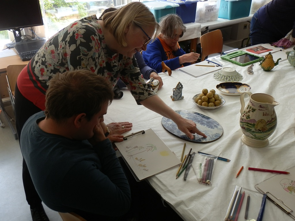 Frank and I discussing his colourful interpretation of the Delftware coney plaque, with Jenny drawing the underside of the Worcester porcelain basket with pierced sides