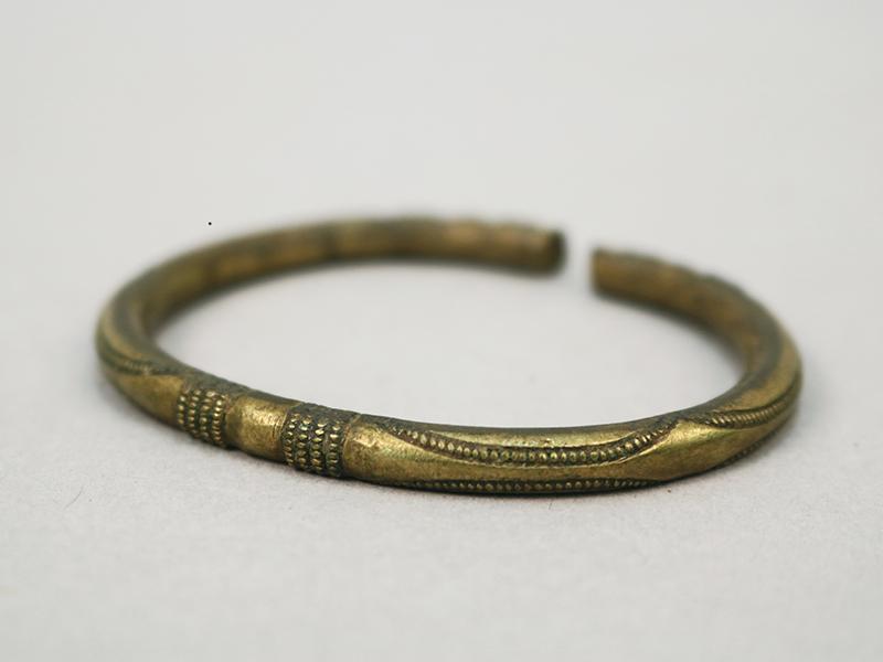 A gold coloured armlet