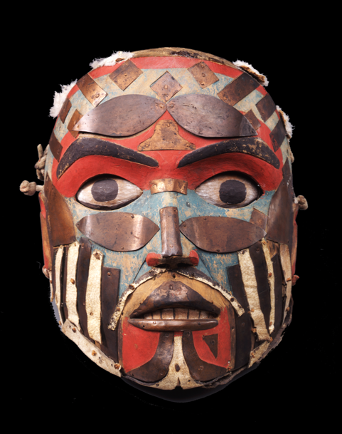 Painted, wooden mask with strips of copper and leather