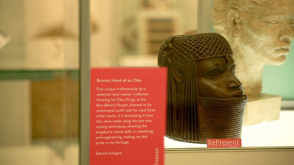 A display of a bronze head of an Oba from Benin City, 18th/19th century