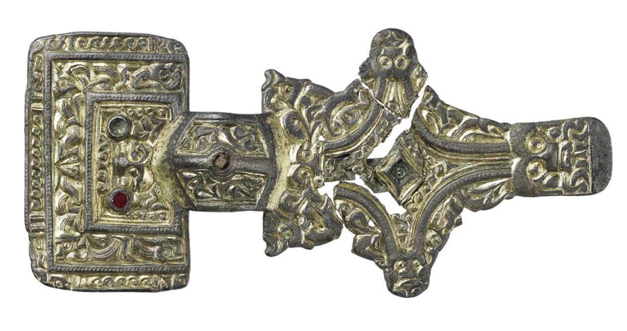 """Z 7106 A. Square headed brooch set with garnets and decorated with """"chip carved"""" zoomorphic ornament in Salin's style I."""