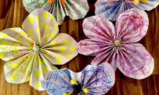 5 large flowers made out of paper