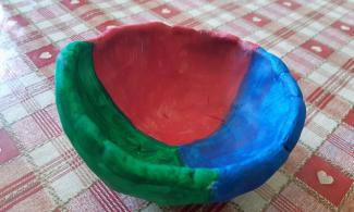 Red, blue and green clay pinch pot