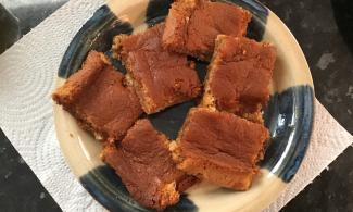 Finished product of Roman-inspired honey cake, cut up into squares