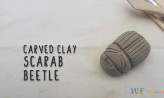 Clay scarab beetle