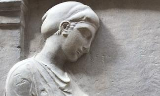 plaster cast of a Greek grave monument showing a young woman