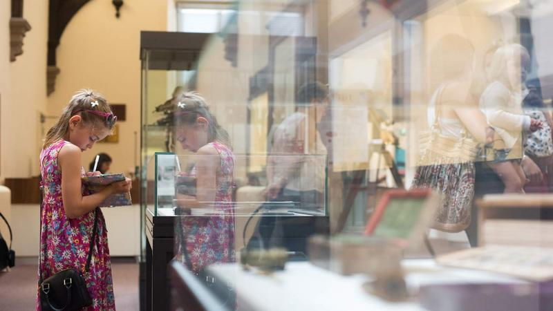 A child exploring the exhibits during summer at the museums